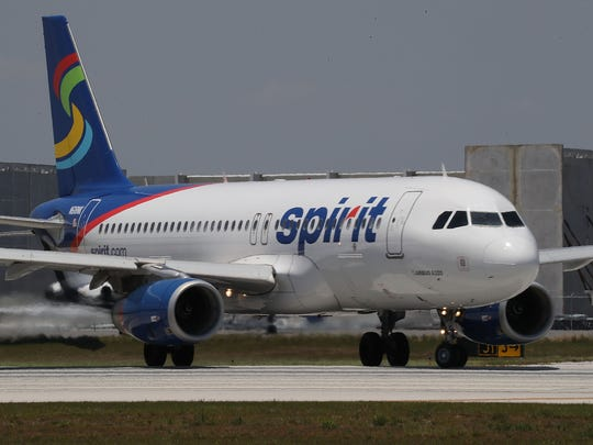 A  Spirit Airlines plane prepares to take off at the