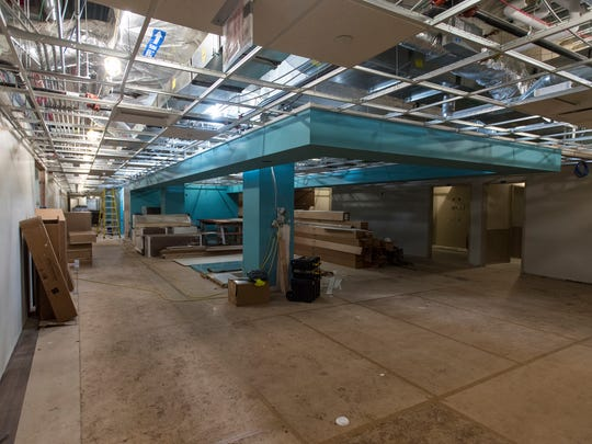 Construction on the nurse's desk on the first floor of the emergency center in the new south tower being constructed at McLaren Port Huron. All nurses stations in the new addition will be painted a blue color to make them identifiable.
