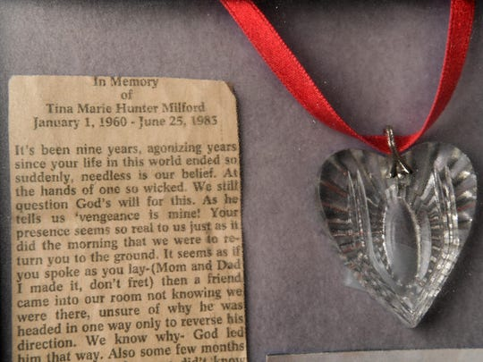 A frames necklace and In Memory newspaper clipping