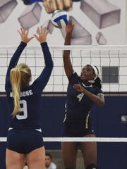 Our Lady of Lourdes' Rebecca Townes, right, hits the ball over the net on Oct. 4 against John Jay.