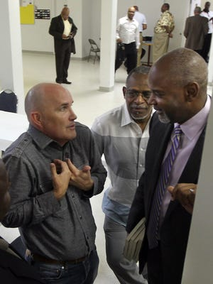 """Chris Beard, left, lead pastor of the Peoples Church, and Pastor Damon Lynch III of the New Prospect Baptist Church confer before a """"conversation"""" with members of the media at Corinthian Baptist Church in Cincinnati on Thursday, July 30, 2015."""