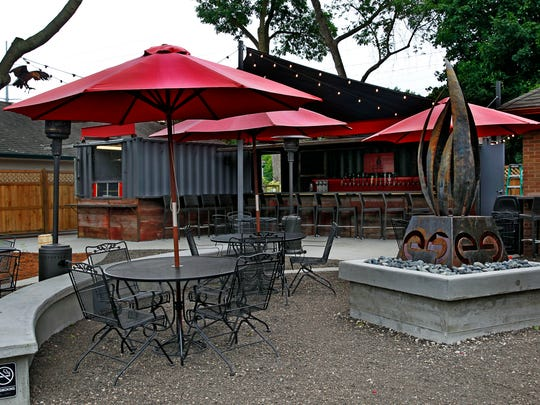 In Thiensville, the Cheel restaurant's new beer garden,  called the baaree, serves drinks and food from two shipping containers (background). It features metalwork by Milwaukee Blacksmith.