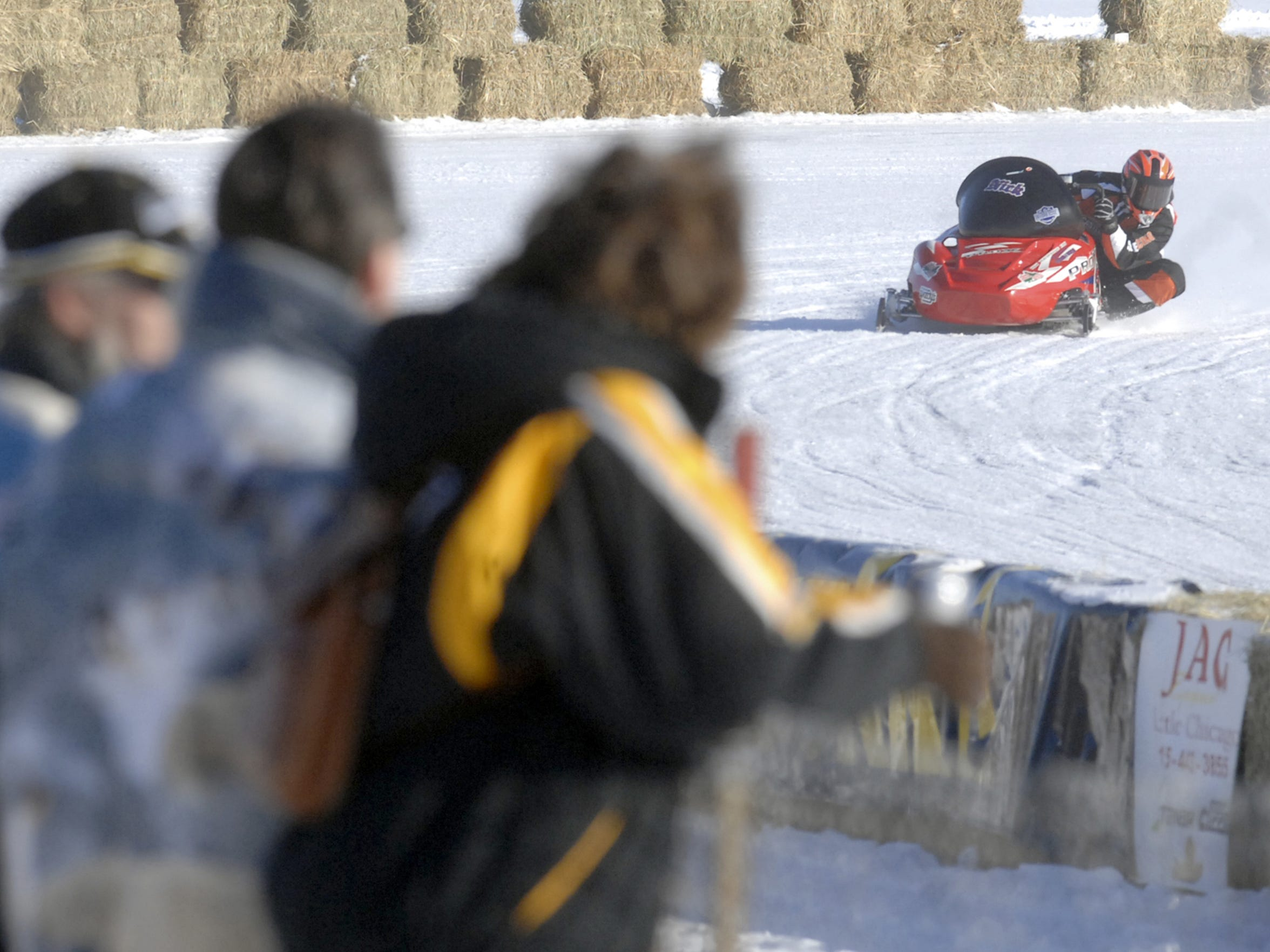 In this 2007 file photo, spectators watch as drivers compete in the Wausau 525 Snowmobile race at Sunnyvale Park.