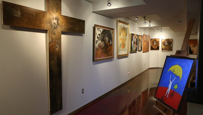 The private art collection of Giovanni and Cindy LiDestri includes work by famed Rochester artist Ramon Santiago in their East Avenue home. The painting at the right is a self-portrait Ramon was working on shortly before his death.