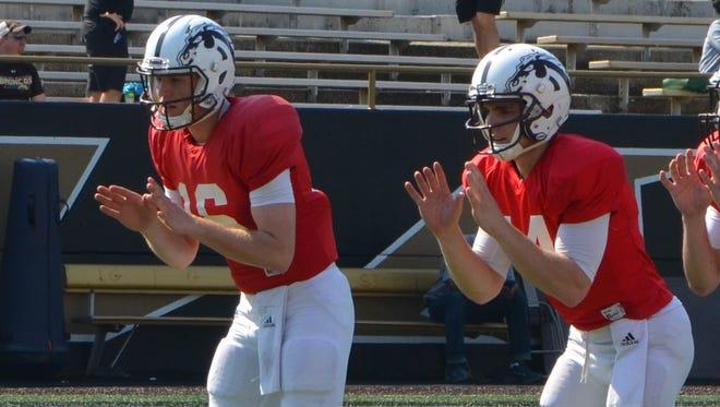 Western Michigan quarterbacks Jon Wassink (16) and Tom Flacco (14) run through drills ahead of the Broncos' annual spring scrimmage on Saturday.