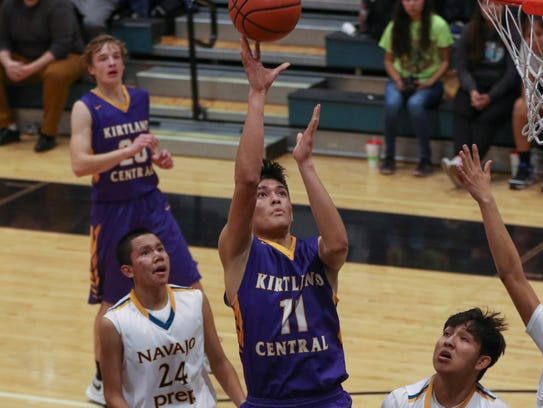 Kirtland Central's Terrin Willie shoots against Navajo