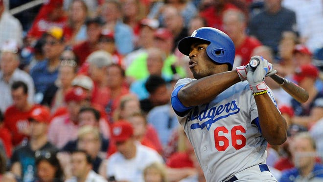 Los Angeles Dodgers right fielder Yasiel Puig (66) hits a double against the Washington Nationals during the fourth inning at Nationals Park.