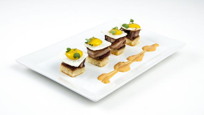 """""""Bacon and eggs"""" from the new Tastes of Bistro menu served at Bistro Napa in the Atlantis features brioche, bacon-wrapped pork belly and quail eggs sunny-side up."""