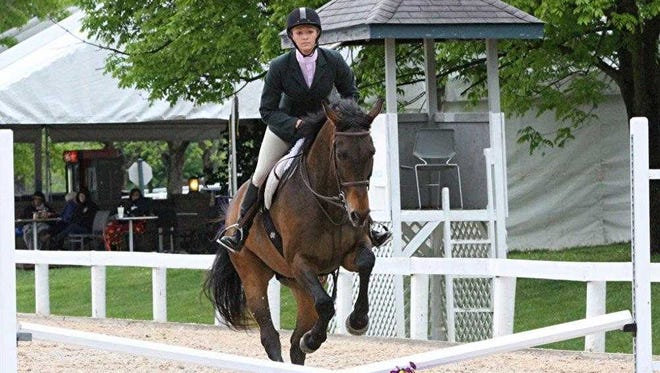 Brass Hat in the show ring with Buff Bradley assistant Chelsey Moysey aboard.