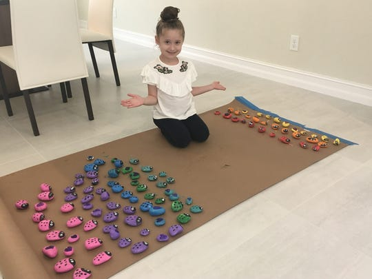 Ayel Morgenstern, 6, of Parkland, Florida, paints stones to be shipped to cemeteries that experienced Jewish vandalism this year.