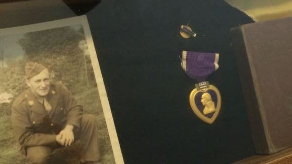 A photo of Wayne Clark of the Purple Heart bestowed to his family after his death.