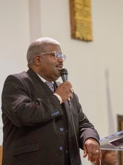 The Rev. Jeffery Baker speaks during St. Paul AME Church's first service in their new location on Sunday, Oct. 5, 2017, in Grosse Pointe Park.