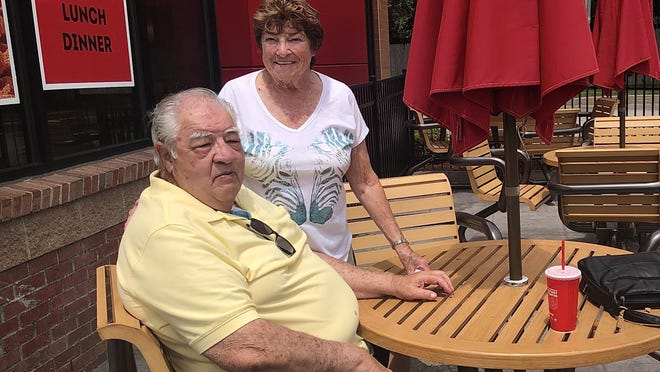 Will and Dee Fourcier ate their lunch Monday at an outside table of a Taunton Wendy's where the dining room remained closed.  Taunton Gazette photo by Charles Winokoor
