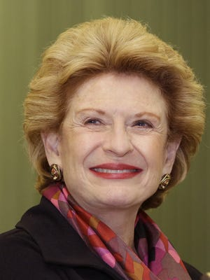Sen. Debbie Stabenow, D-Mich., is seen during a rally in Livonia, Mich., Thursday, Oct. 2, 2014, for Bobby McKenzie, a counterterrorism expert running for Congress in a Republican-leaning district outside Detroit. McKenzie is running against Republican lawyer and businessman David Trott for the 11th District seat currently held by GOP freshman Rep. Kerry Bentivolio. Trott beat Bentivolio in the August primary. (AP Photo/Carlos Osorio)