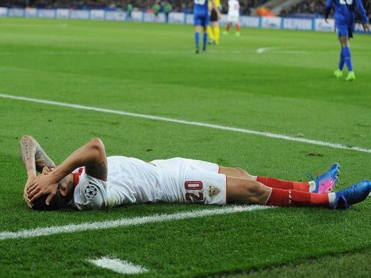 Sevilla's Vitolo lies on the floor after a missed opportunity during the Champions League round of 16 second leg soccer match between Leicester City and Sevilla at the King Power Stadium in Leicester, England, Tuesday, March 14, 2017. (AP Photo/Rui Vieira)