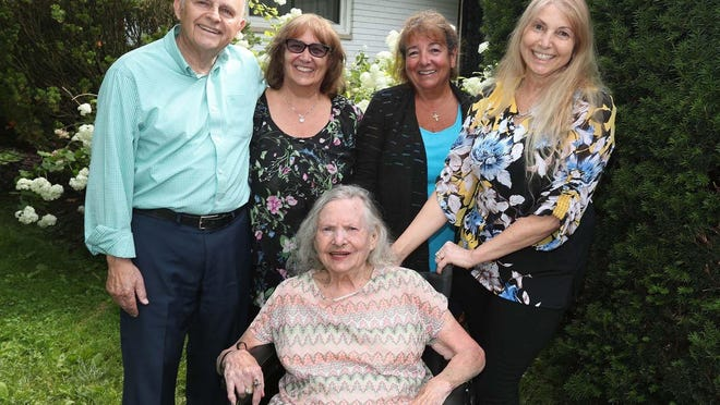 Jackie Shama, who turned 96 years old this Sunday, with her daughters, from right, Kim Shama-Hanna, Cindi Shama, Debbie Shama-Davis and her husband Steve Davis at Jackie Shama's home Wednesday in Fairlawn. Jackie Shama, her daughter Kim and her son-in-law Steve are all survivors of COVID-19.