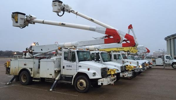 Utility trucks are staged at the Mississippi Fairgrounds in Jackson.