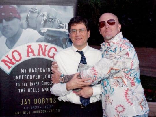 "Jim Reed and Jay Dobyns at a backyard celebration of the 2009 release of Dobyns' book, ""No Angel."""