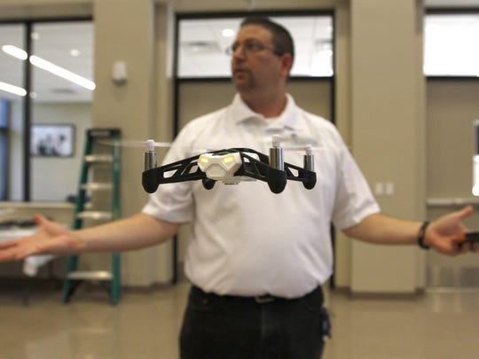 Florida SouthWestern Collegiate High School technology teacher Lance Schreiber instructs his class on the ups and downs of flying drones Thursday, Sept. 3 in Fort Myers.