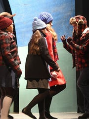 The cast of A Christmas Story rehearse Monday evening at the Renaissance Theatre. Jason J. Molyet/News Journal