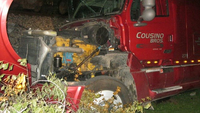 A semi's cab is smashed after a train collided with it Thursday night.
