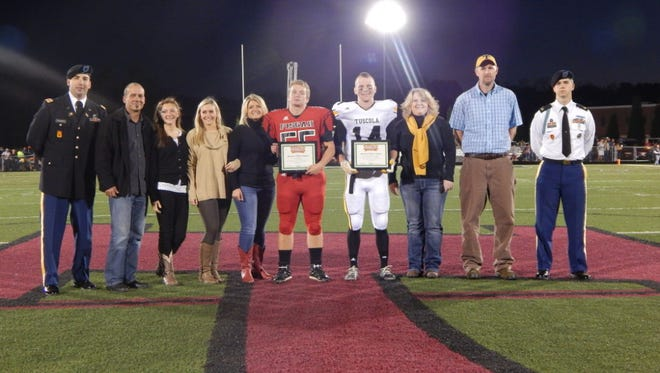 Pisgah and Tuscola players were presented with scholar-athlete awards from the Great American Rivalry Series in 2014.