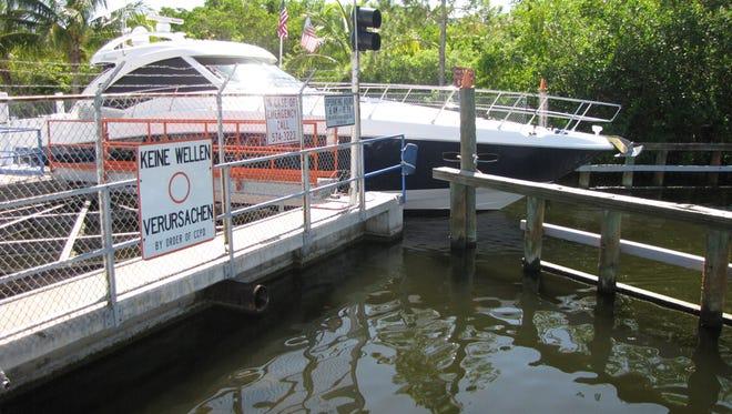 A boat passes through the Chiquita Lock.