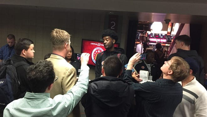 Josh Jackson gets swarmed by reporters at McDonald's AA media day.