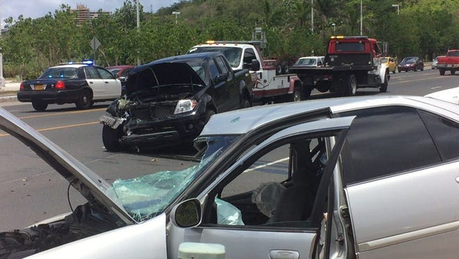 Guam Fire Department personnel assisted motorists involved in a two-car crash in front of the Hagåtña McDonald's on Thursday, May 19.