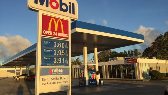 The sign at the Mobil gas station in Maite shows a 20 percent increase in regular fuel, a jump from $3.41 to $3.61 a gallon on May 24.