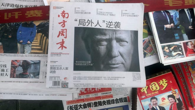 A front page of a Chinese newspaper with a photo of President-elect Donald Trump shortly after Election Day. Trump spent much of his campaign blaming China for U.S. economic woes.