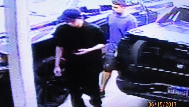 Two men broke broke into a house and stole clothing, electronics and cash before leaving in a white Lincoln on June 15, 2017.