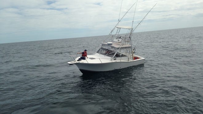 The Coast Guard rescued two men after they reported an onboard fire  on their boat 14 miles northeast of Chincoteague Friday evening.