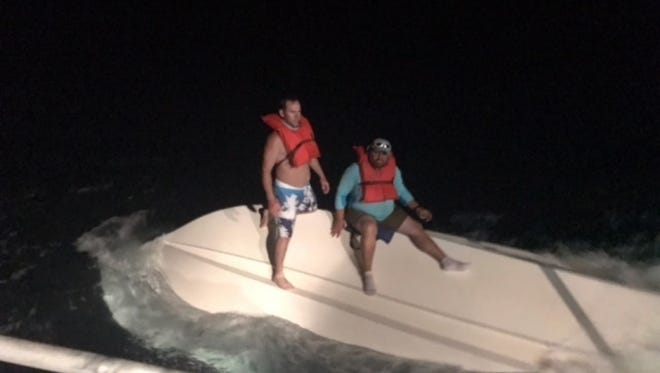 A boat crew from Station Fort Myers Beach rescues two missing boaters approximately 40 miles west of St. James City on Monday, Sept. 18, 2017.