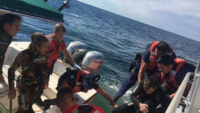 A boat crew from Coast Guard Station Fort Myers Beach medevacs a 26-year-old man from a 27-foot dive boat, Reel Cowboy, 31 miles west of Naples, Sunday. The Coast Guard, in partnership with Fort Myers Beach Fire rescue, transported the man to shore where an ambulance awaited.