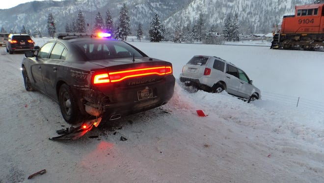 Trooper Wes Witlatch had been parked on the shoulder in low visibility when a vehicle attempted to change lanes and lost control. No injuries resulted in the crash.