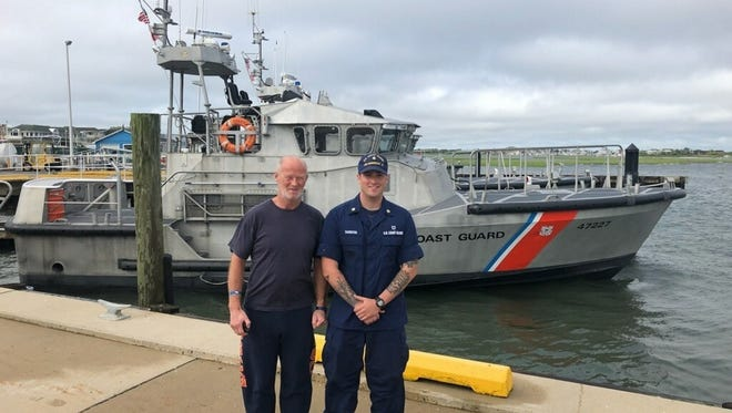 Petty Officer 2nd Class Eric Thornton, a Surfman at Coast Guard Station Barnegat Light, poses for a photo with Duncan Hutchison, Monday, June 4, 2018. A 47-foot Motor Lifeboat (MLB) crew from Station Barnegat Light launched to respond and rescued Duncan after he became beset by weather about 20 miles east of Barnegat Light, New Jersey. U.S. Coast Guard courtesy photo