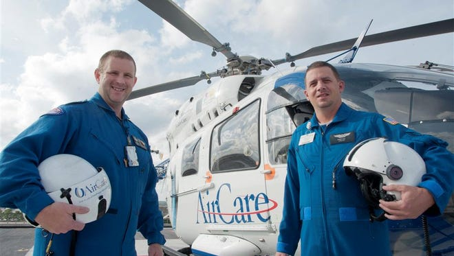 UMMC AirCare paramedics Kevin King (left) and Stacy Gill are among six flight crew members who have earned critical-care paramedic certification.