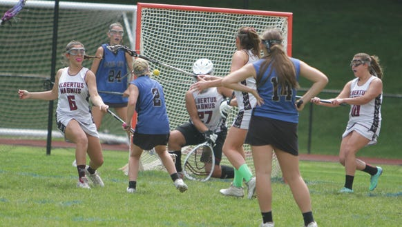 Action during a Section 1 girls lacrosse tournament