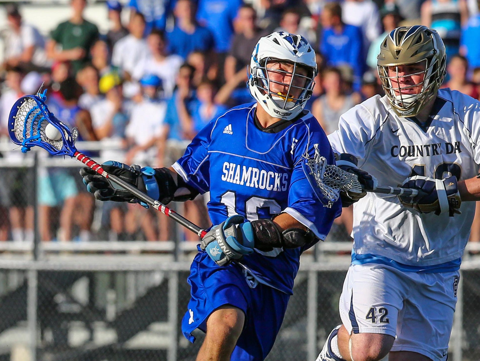 Catholic Central's Nick Capatina (left) shields off Country Day's Matt MacLean in Wednesday's Division 1 semifinal.