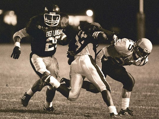 East Lansing's Randy Kinder cuts upfield during a 1992