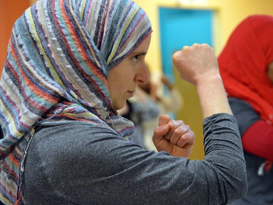 Sakeenah Franzen holds up her fists as she prepares to attempt a front kick during a self defense class in Washington.