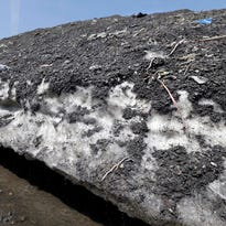 A massive pile of snow and debris remains in Boston following a record snowy winter.