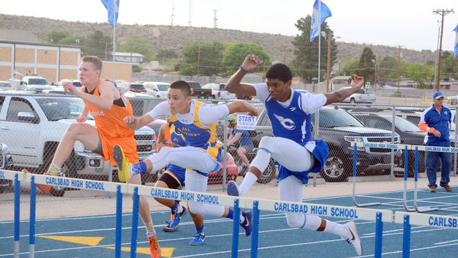 Carlsbad's Davion Young competes in the boys 110-meter hurdles on Monday, placing third in that event.