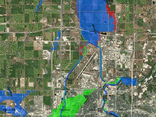 A draft of a new flood plain map released by FEMA takes a large portion of land (green) that straddles the Big Sioux River out of the flood plain. But an area north of Sioux Falls (in red) is being added, which would require some homeowners in the area to buy flood insurance.