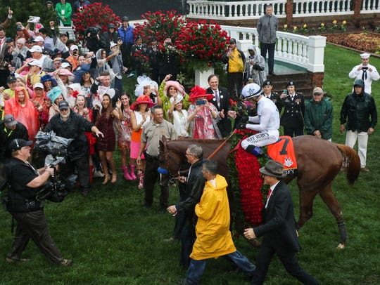 Justify in the winners' circle after the 2018 Kentucky Derby.