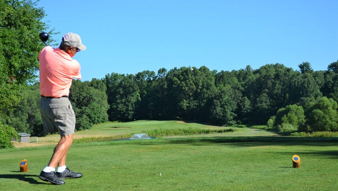 Battle Creek's Don White tees off at Binder Park Golf Course - which has long been known as one of the top golf courses in Battle Creek.