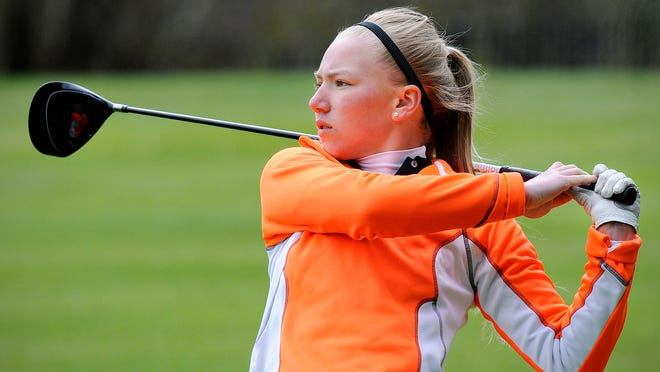 Tech's Marren Pfannenstein watches her shot from the seventh tee during Thursday's girl's golf invitational at the St. Cloud Country Club.