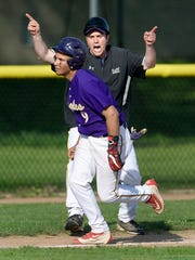 East head coach Kyle Crandall, right, sends Tyrone Roundtree home to score the go-ahead run on an error after his two-run triple in the fifth inningduring the RCAC championship game at East High School, Thursday, May 17, 2018. East won the RCAC title with a 3-2 win over Franklin.