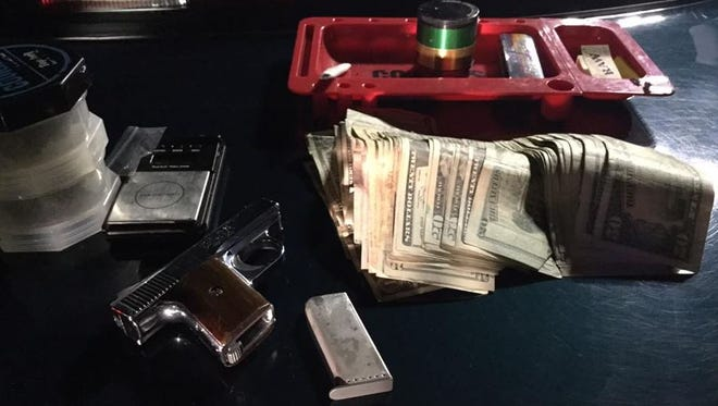 Cash, a loaded weapon, marijuana and more were seized during the arrest